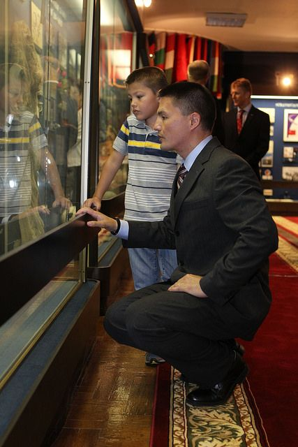 Kjell Lindgren explains one of the historic artifacts in the Gagarin Museum at the Star City cosmonauts' training center to his son. Photo Credit: NASA