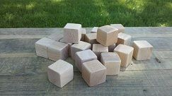 20 wood blocks measuring 1.5 x 1.5 inches. Unfinished or finished with natural child safe bees wax or coconut oil. Edges are either not sanded or sanded to round shape to make them safe for children to play with. Blocks come with a handmade bag Wood type is Oak.
