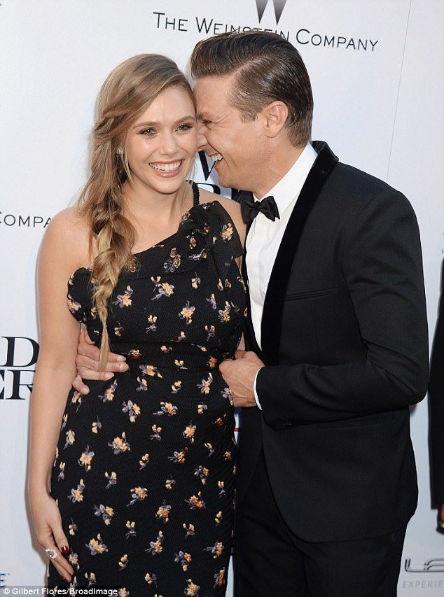 Affectionate: Jeremy Renner and Elizabeth Olsen had a laugh together at the Los Angeles premiere of the decidedly bleaker new film Wind River