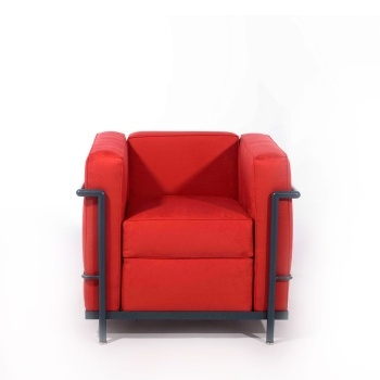 Armchair covered in fabric with chromed steel frame, stuffed with high density expanded polyurethane, chair cushion is stuffed with feathers.
