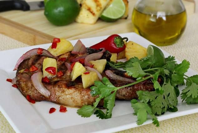 Easy paleo recipe for grilled pork chops with a spicy chili pepper salsa