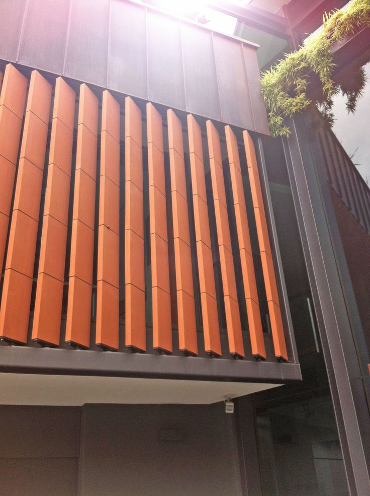 Incredible louvre project (Brisbane) - Our client imported custom made terracotta louvres from Europe & Vanguard installed  with our spiral pivot system.