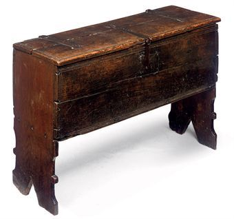 AN ELIZABETHAN OAK PLANK CHEST  LATE 16TH CENTURY  With strap hinges, moulded edges and slightly tapered V-cut ends  24½ in. (62 cm.) high; 37 in. (94 cm.) wide; 12½ in. (32 cm.) deep