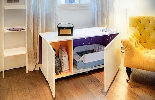 Hide your cat food and litter box in a cabinet - keeps the kitty potty hidden and the area clean!