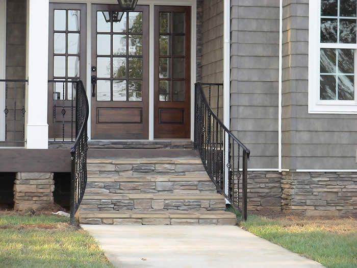 i like this whole look from the stacked stone porch porch railing and front - Patio Handrail Ideas