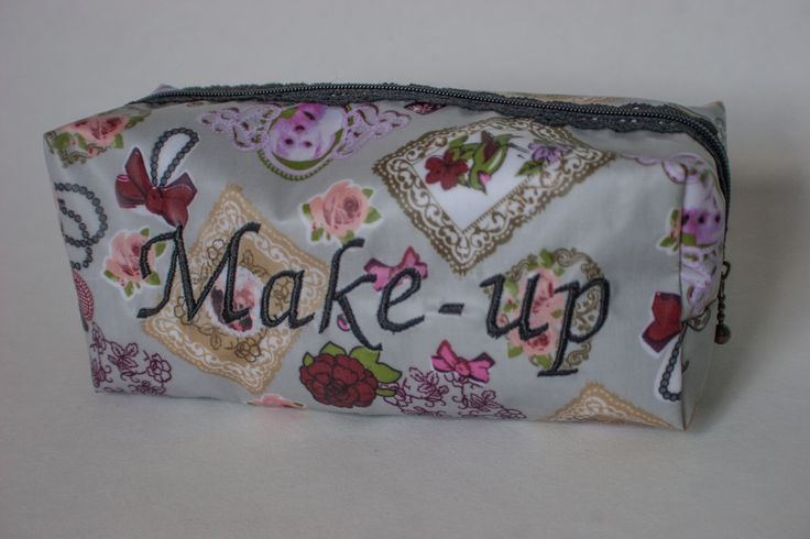 Machine embroidered 'make-up' slogan viny coated cotton cosmetic bag with lace…