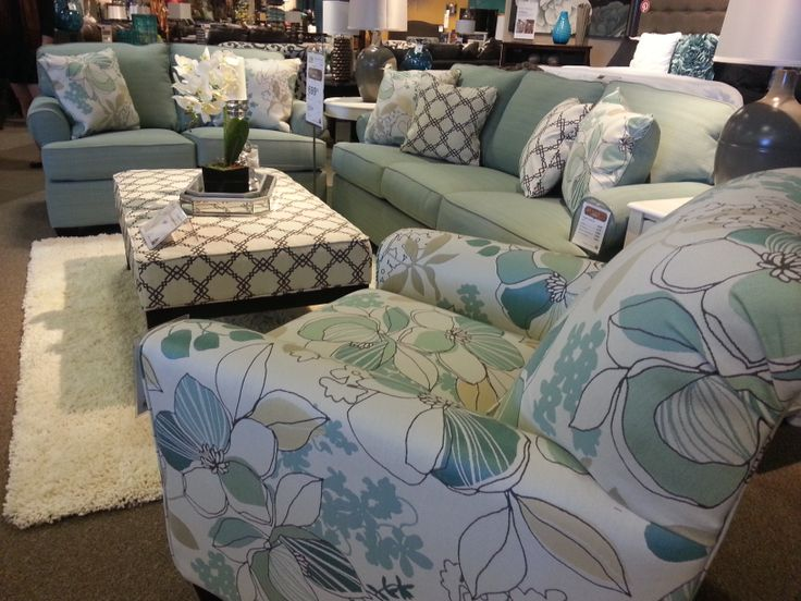I love the mixing of prints and patterns on this contemporary sofa set!