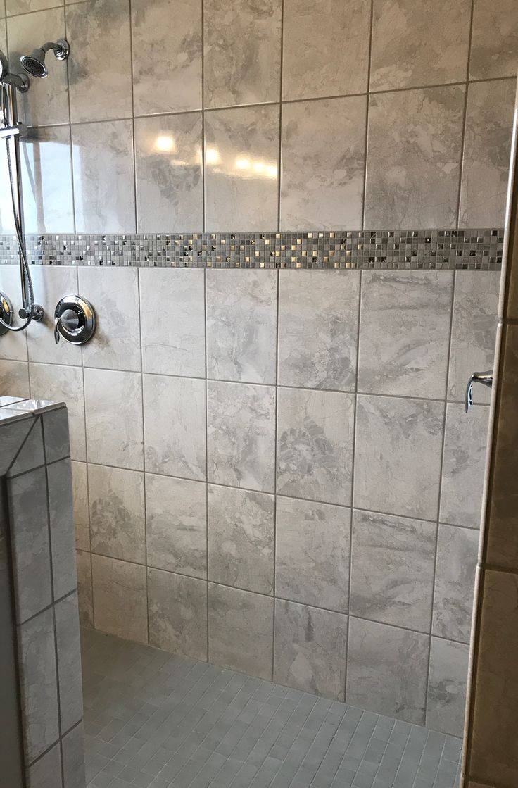 Marble Falls White Water 10x14 Wall Tile With Marvel Whimsical Listello Strip In Garden Shower