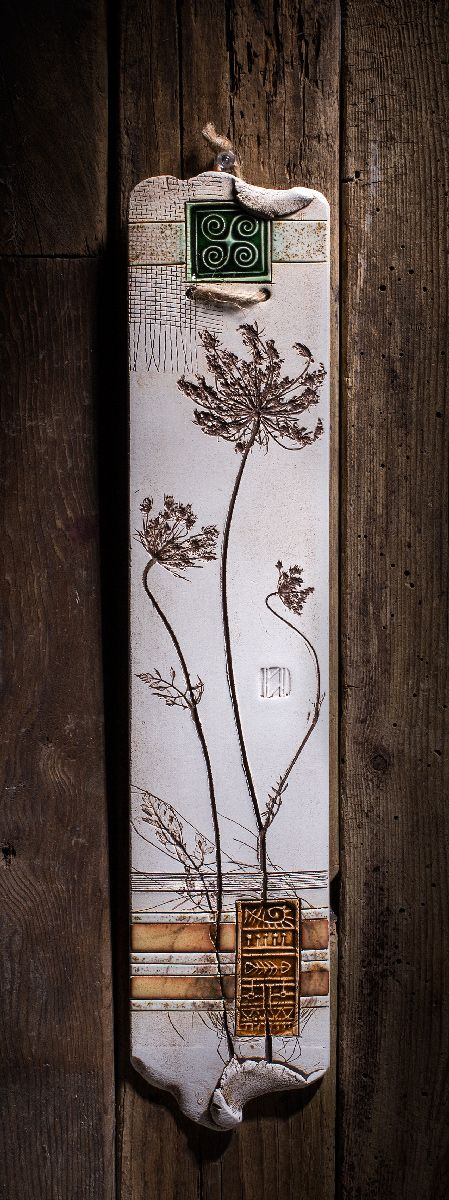 """Botanical pieces have been pressed into the wet clay to create the elegant look of those wall plaques.Varied textures and vibrant colors make them an exquisite piece of the home decor ( W 3"""" x H 14"""" )"""