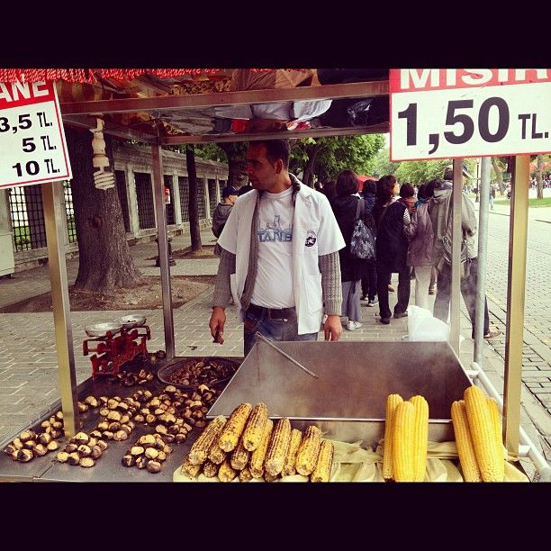 The grilled corn and roasted chestnut sellers in Istanbul - perfect for a rainy day