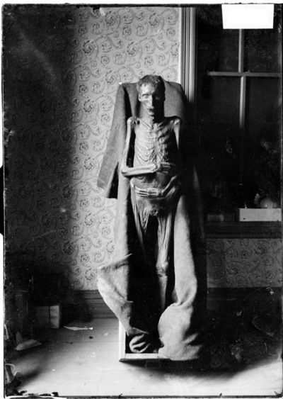 This information that comes with this photo states the mummified body pictured was unearthed in Chicago on Oct. 29th, 1903. It goes on to say the body was dug up in a gravel pit at 56th St and South Park Ave wrapped in carpet inside a long box. Murder was suspected, but the body was never identified.  I haven't been able to dig up any more details to support the story.