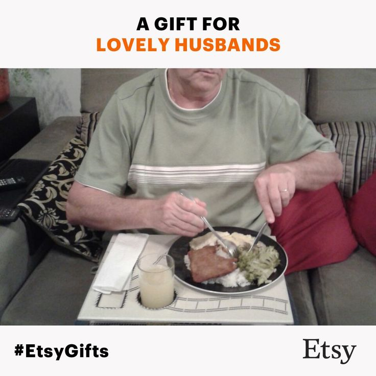 A happy husband enjoying his meal using the serving tray he got as shift from his loving wife!