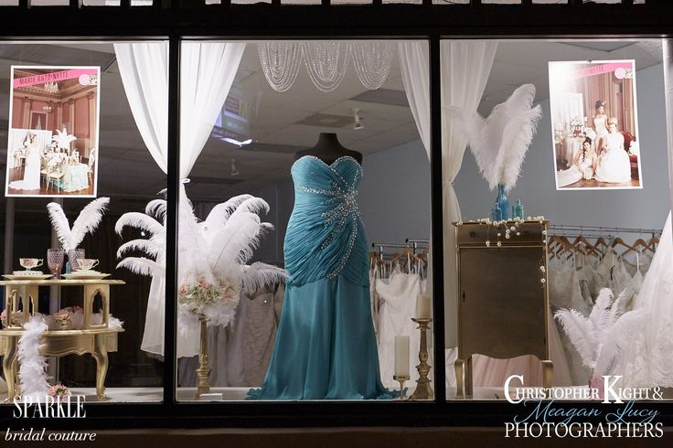 Pops of colored dresses, multi-hued glass, floral work, feathers, and gold furnishings really make our June window unique. There are so many beautiful details added to the decor to make this window special. http://simplecountryweddings.com/  http://accentsbysage.com/ Photo By Meagan Lucy http://www.kightphoto.com/meagan-lucy/ #sparklebridal #sparklebridalcouture #christopherkightphotographers #realweddingmagazine #sacramentobride #marieantoinette @simplecountry @accentsbysage