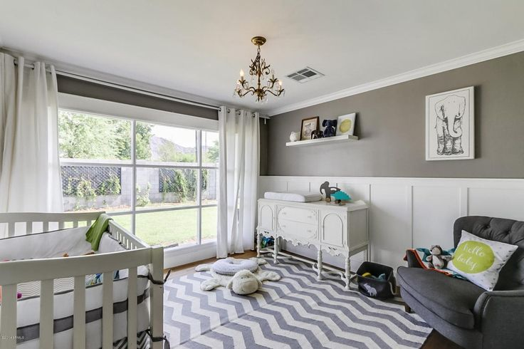 Transitional Kids Bedroom with Crown molding, Hardwood floors, Pendant light, Wainscoting, Carpet