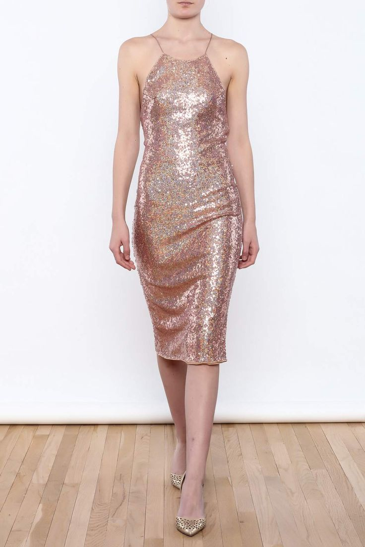 Sequin midi dress with an exposed back, adjustable back tie strings, hidden zipper closure and a back slit.   Strappy Sequin Midi Dress by Hommage. Clothing - Dresses - Midi New York City Manhattan, New York City