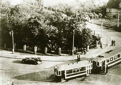 Operation Anthropoid: Heydrich's car is at left, partly blown apart by a stick of dynamite tossed by one of the assassins.