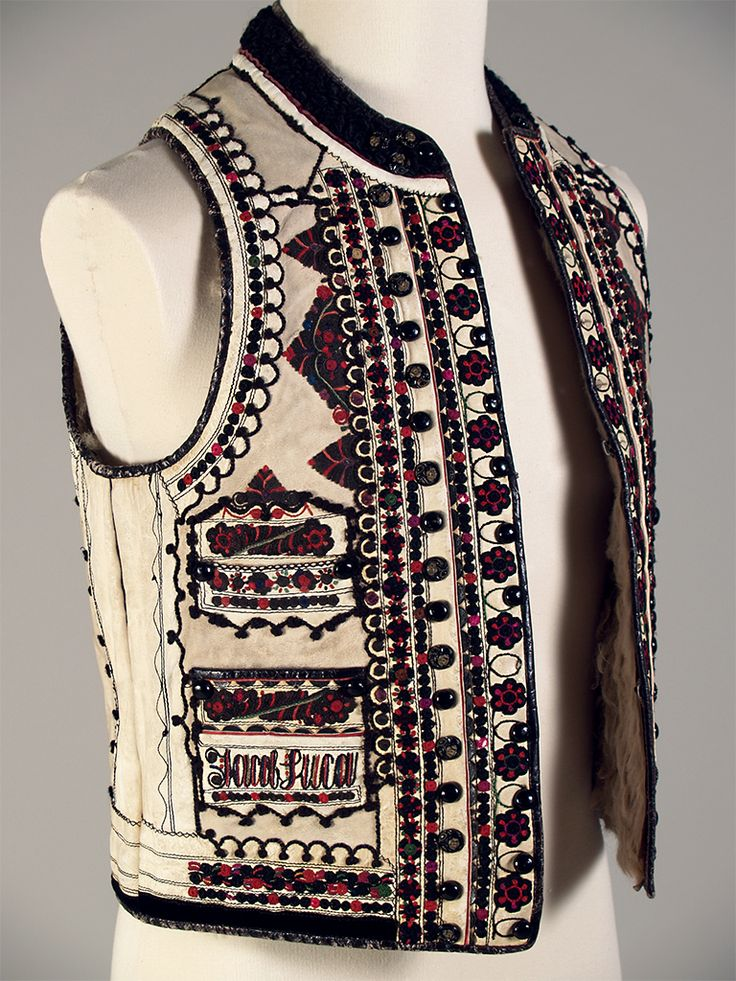 """Ivory sheepskin vest (peiptar) with predominantly black and red embroidery. Transylvania region of Romanian, inscribed """"Jacob Luca 1927."""""""