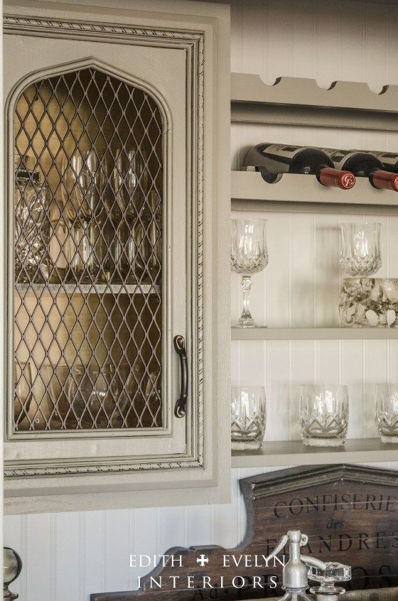 GREAT IDEA - Modified the upper cabinets in the bar area, by cutting out the center of the door, and adding metal grate to the backside. The grate is actually replacement grate for a bbq grill that we painted in oil rubbed bronze paint! Very inexpensive for a fabulous look!