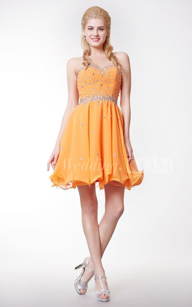 Flaunt your hourglass figure in this ravishing, body hugging, zip-up empire waist short prom dress. With a fun and rounded zig-zag hemline, this dress is both stylish and formal, topped off with elegant jewel embellishments all over the bodice and scattered through the rest of the dress. This dress will have all your friends talking long after the night is over! #yellow #short #homecoming #DorisWedding.com