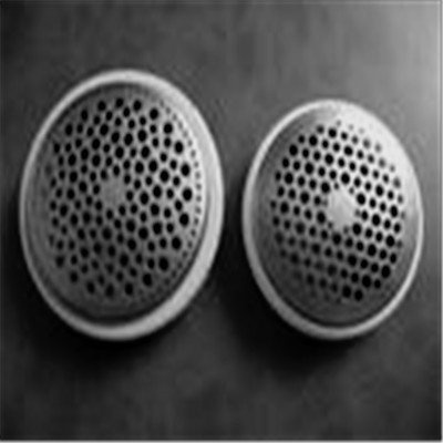 No idea what they are. They could be grilles for speakers or an intercom. However they have been punched and then pressed into a shallow dome.
