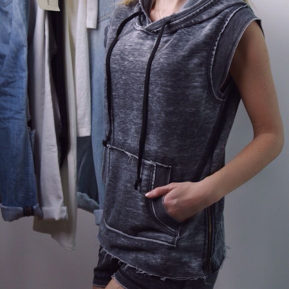 Gray Raw Edge Sleeveless Hoodie 👟 I looove this for Spring + Summer. SO SOFT sleeveless hoodie with a charcoal faded wash and raw edge accent . Zipper on both sides that can also be worn unzipped. Cool and chic - very Alexander Wang. Interior is fleece lined and the outside feels just as nice. Very well made. 60% cotton, 40% poly. Sizes small, medium, large available. New with tag. Shorts also for sale. Boutique Tops Sweatshirts & Hoodies