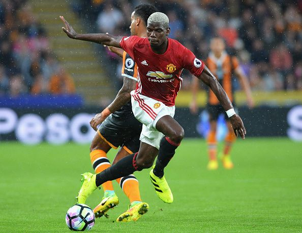Paul Pogba of Manchester United is fouled by Tom Huddlestone of Hull City during…
