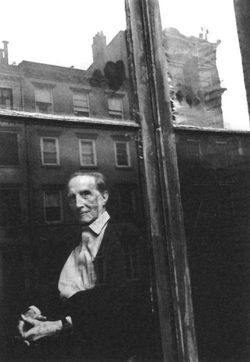 """Marcel Duchamp at home, New York, 1962. By Duane Michals. """"We are a brilliant and unknown moment, suspended between memory and anticipation, anxious in our uncertainties, and doomed to fade with our consciousness. How can such a mystery be photographed? What is left for us but amazement?"""" — Duane Michals, in 'I Am Much Nicer Than My Face: and other thoughts about portraiture' - from Los Angeles Times (1989)"""