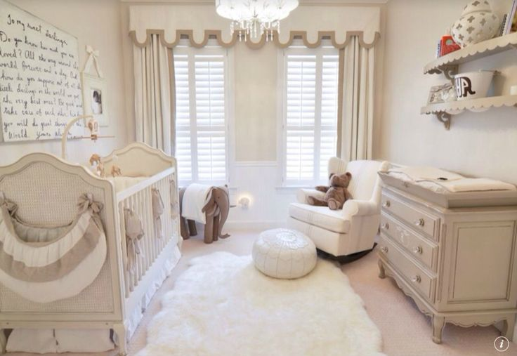 Here's another beige and white nursery, centered around a white fur rug. Reclining armchair with ball-style ottoman sits between beige changing table / dresser and full wood crib. Carved wood shelving and hung white board adorn the walls.