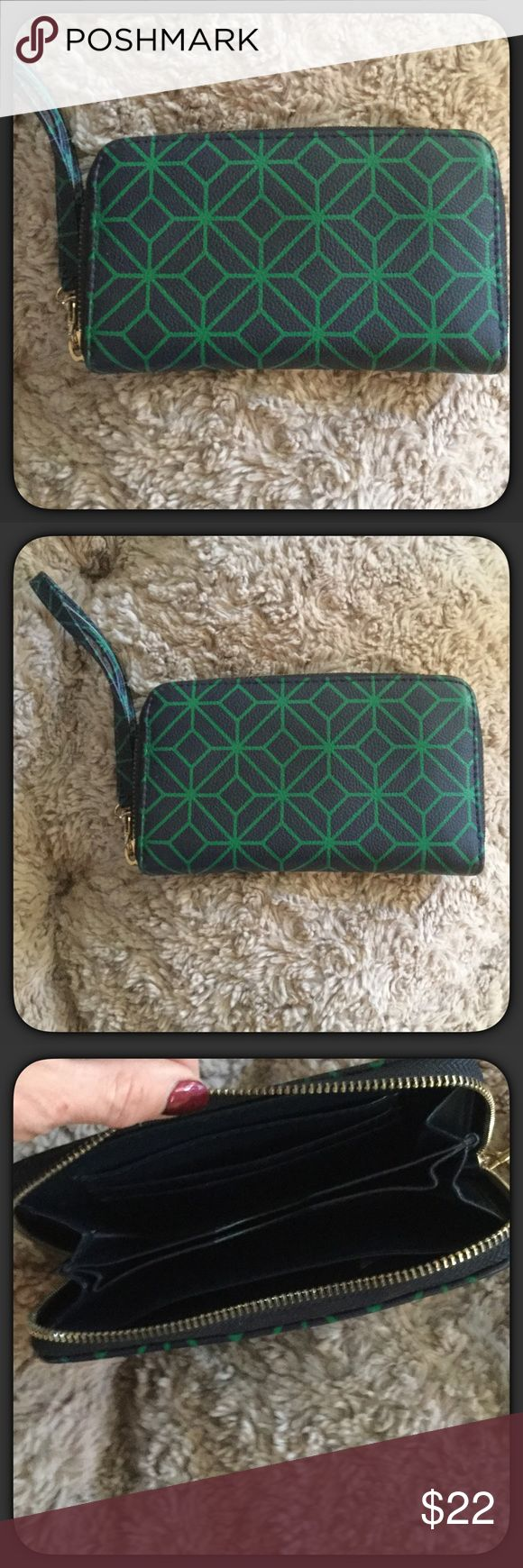 """🆕Wristlet - Faux Leather - Navy & Green Navy blue and green geometric print wristlet. Wrist band can be taken off to use as a wallet. Faux pebbled leather (man made materials). Soft feeling. Inside is Navy blue with side pocket and slots for ID, etc. center pocket. Zips all the way around. This is a boutique item it is NWT ( new in package) but I do not tag my retail items. Measures 7"""" x 4"""" with a 5"""" opening. Super cute! Boutique Bags Clutches & Wristlets"""