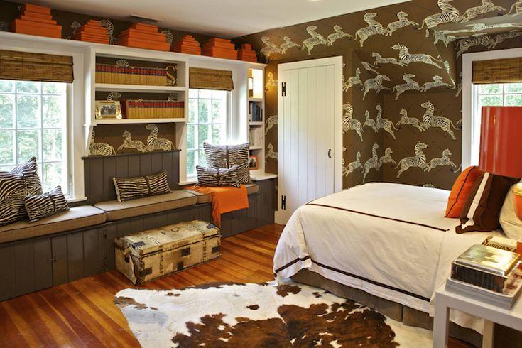 Brown and orange boy's room features walls clad in Scalamandre Zebra Wallpaper in Safari Brown ...