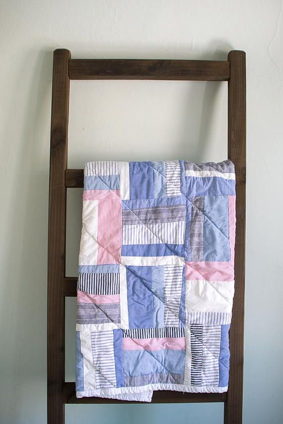Made from eight mens dress shirts, this up-cycled quilt features 100% cotton fabric in a variety of patterns and textures. All shirts were purchased at the Amvets Thrift Store on Elmwood Avenue in Buffalo, NY, and were laundered before being used in this quilt. The quilt measures 36 x 41 and is bound in a white cotton. It is backed with white flannel. Please note that because of the variety of cotton fabrics used in this quilt, it has a lot of texture and volume. ___  Local Color quilts are…