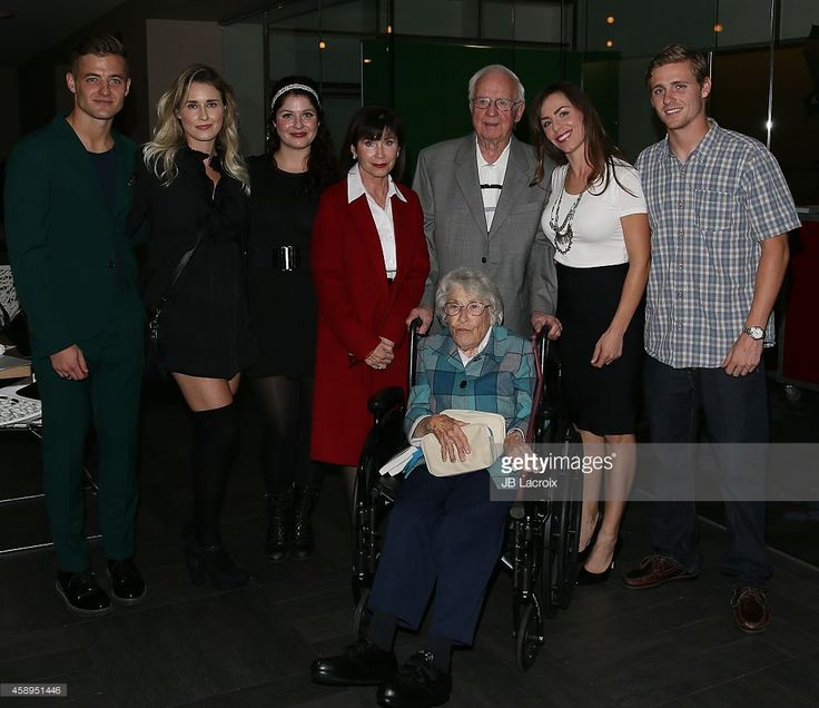 Robbie Rogers (L) and his family attend the release of his memoir 'Coming Out To Play' on November 13, 2014 in West Hollywood, California.