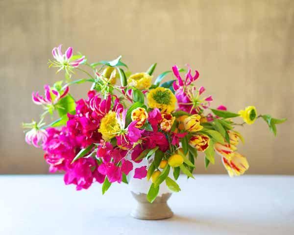 Tulipina, floral arrangement of gloriosa lilies, kumquats, flame tulips, yellow ranunculus, bougainvillea