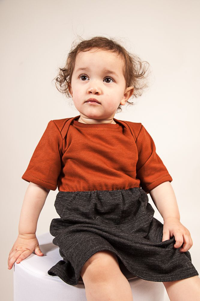 AAMcEvoy AW17 Short sleeve dress in Henna/Charcoal mix. Also available in Grey/Charcoal  Henna- 100%organic cotton Charcoal mix skirt- 64%organic wool 36% organic cotton  MADE IN IRELAND