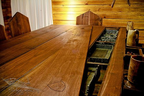 Gaming Table with multiple levels... Not to mention the awesome room that surrounds it. Epic levels of pure WANT!