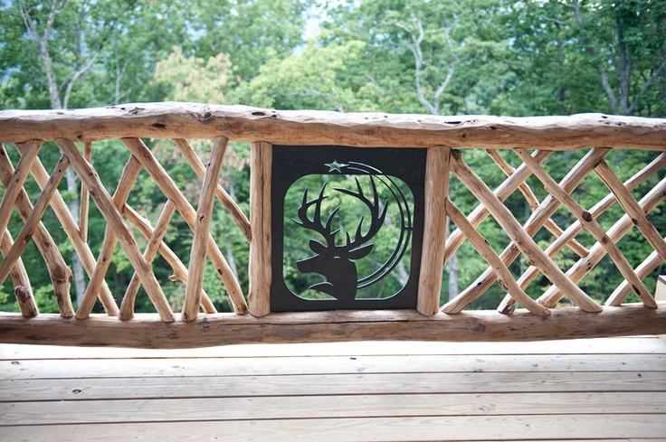 Overlooking the perfect spot in Black Mountain, NC we used custom iron work to help set off this locust railing.