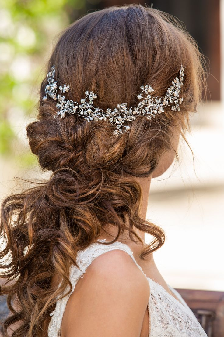 Bridal headpiece in gold, with lace bridal robe.   Maria Elena accessories from Solutions Bridal