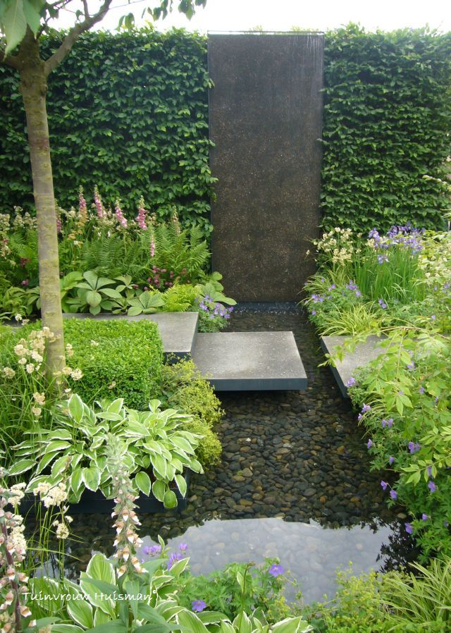 Subtle water feature integrated into the garden. Pinned to Garden Design - Water Features by Darin Bradbury.