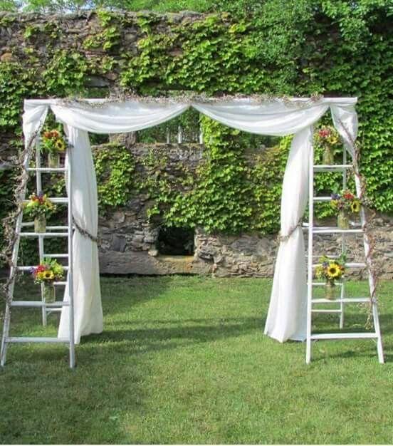 Old ladder turned wedding arbor!