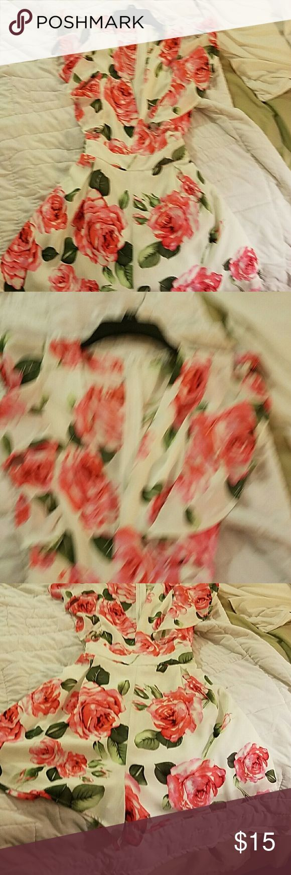 Beautiful Charolette Rouse Rouse Adorable cream romper with pink roses and a deep v neck in the front. Cute cap sleeves and it ties in the back. Charlotte Russe Shorts