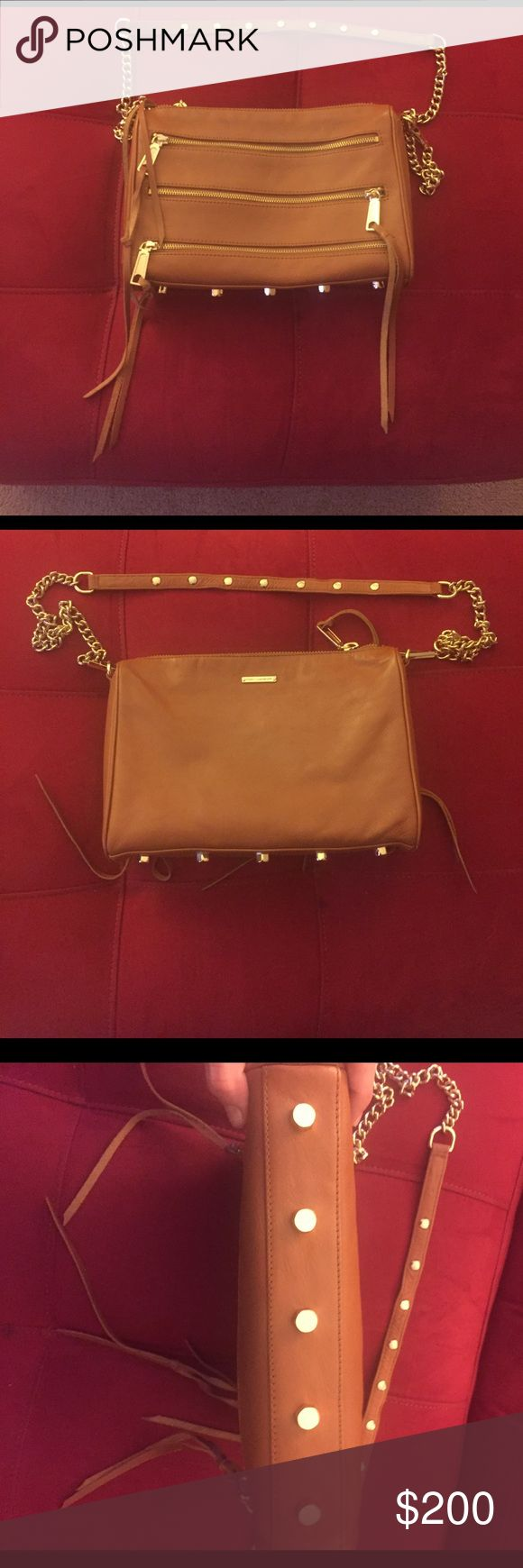 Rebecca Minkoff Full Size 5 Zip Purse Rebecca Minkoff Full Size 5 Zip Purse. Worn/carried only a handful of times - I just wear black all the time. Can be worn on be shoulder or as a crossbody. No trades and price is firm. Rebecca Minkoff Bags