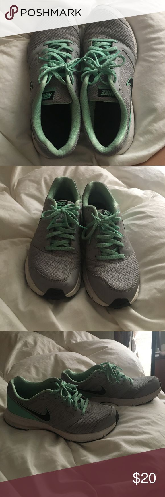 Nike Tennis Shoes Women's Turquoise and grey Nike tennis shoes, used but in EXCELLENT condition, size 7.5. BUNDLE AND SAVE! Nike Shoes Sneakers