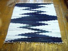 Denim Rug: so love this!!! It would be beautiful in my bathroom floor, thinking about trying to crochet something like it with old jeans and/or tshirts!!!