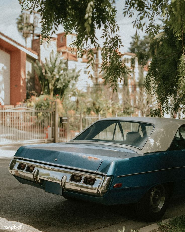 Old classic car parked by the road in los angeles free