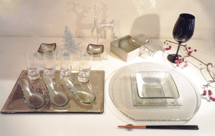 Asian dining setup - round show plate with square inlet for placing noodle/rice bowl; silver tray with glass spoons, chopstick rest and box with glass lid.