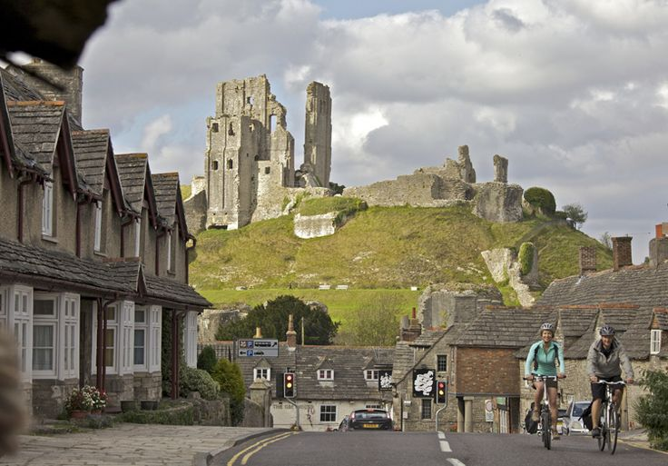 Corfe Castle, Dorset - Does it get any more romantic than cycling through an English coastal town with a castle in the background?
