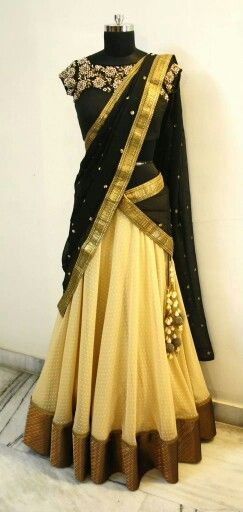 Cream lehanga, black dupatta or oni with polka dots and gold border, black blouse with floral work. Langa oni or half saree or ghagra. Mrunalini Rao.