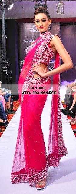 Hot Pink Saree in tulle net with fused velvet and swarovki elements, highlighted with intricate silver zardosi yarn this wedding saree is definitely a show stopper for an evening function with its tailored pallo and sheer neck halter style blouse. For more info email info@adsingh.com