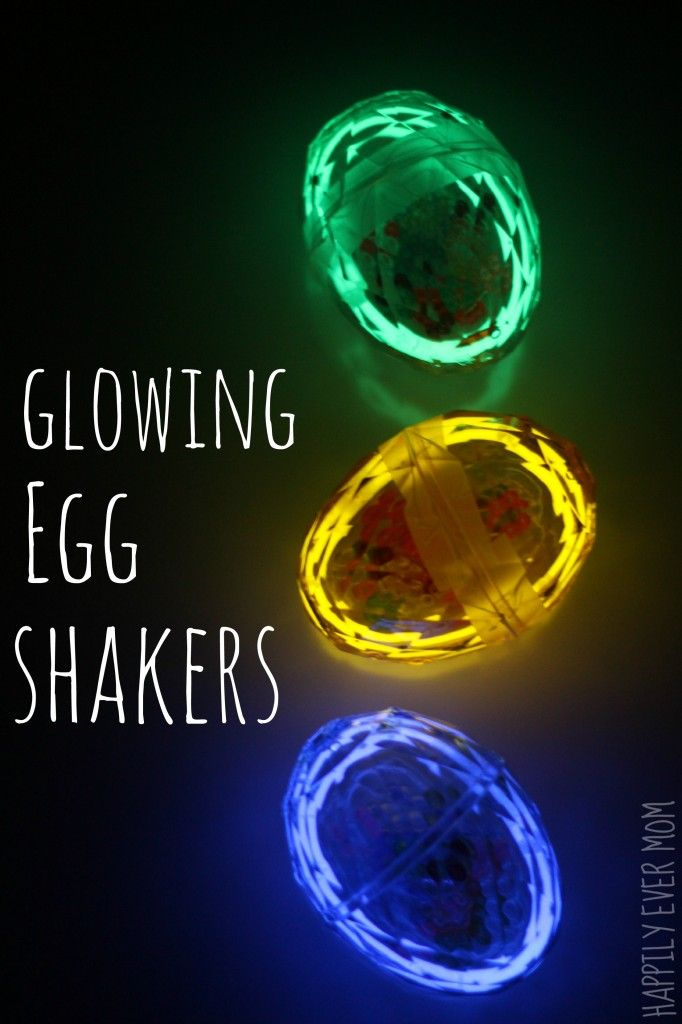 Glowing plastic eggs on black background