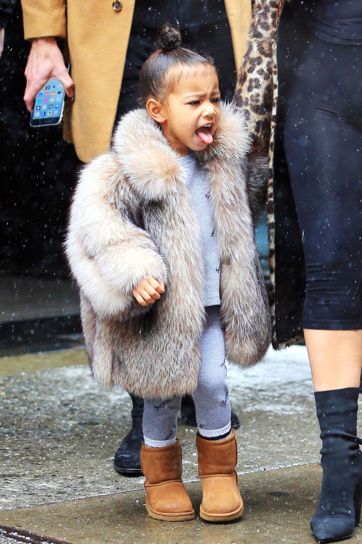 North West Steps Out in Fur Coat and Pink Sweatshirt